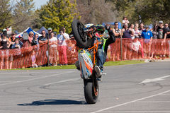 Motorcycle Stunt Rider - Wheelie. VICTORIA/AUSTRALIA - SEPTEMBER 2015: Stunt motorcycle rider performing at a local car show on the 13 September 2015 in Corowa Royalty Free Stock Photos