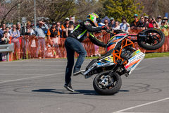 Motorcycle Stunt Rider - Wheelie. VICTORIA/AUSTRALIA - SEPTEMBER 2015: Stunt motorcycle rider performing at a local car show on the 13 September 2015 in Corowa Stock Photo