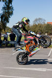 Motorcycle Stunt Rider - Wheelie. VICTORIA/AUSTRALIA - SEPTEMBER 2015: Stunt motorcycle rider performing at a local car show on the 13 September 2015 in Corowa Royalty Free Stock Images