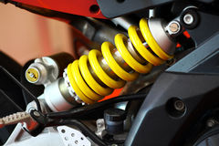Motorcycle suspension. Color shot of a motorcycle shock absorber Royalty Free Stock Images