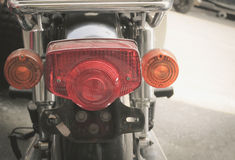Motorcycle tail lights. Old and dirty vintage motorcycle tail lights (tail lamp or rear lights), selective focus stock image