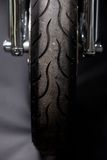 Motorcycle tire. Color shot of a motorcycle forks and tire Royalty Free Stock Photo