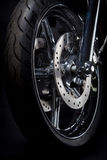 Motorcycle tire. Color shot of a motorcycle forks and tire Royalty Free Stock Photography