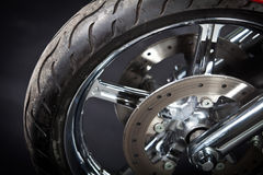 Motorcycle tire. Color shot of a motorcycle forks and tire Stock Photos