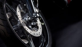 Motorcycle tire. Color shot of a motorcycle forks and tire Royalty Free Stock Photos