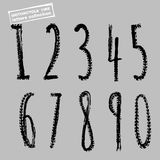 Motorcycle Tire Font Figures Black-01. Grunge motorcycle tire figures. 1, 2, 3, 4, 5, 6, 7 8 9 0 Unique off road  lettering in a black colour on a light grey Stock Photo