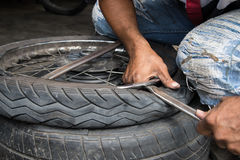 Motorcycle tire repair Stock Images