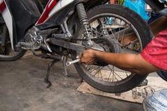 Motorcycle tire repair Royalty Free Stock Photo