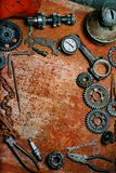 Motorcycle tools, equipment and repair, chain, gearÑ– on vintage metal backgroun. Vertical background. Motorcycle tools, equipment and repair, old chain, gear royalty free stock photos