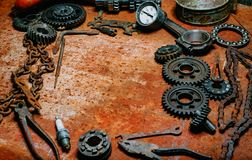 Motorcycle tools, equipment and repair, chain, gearÑ– on vintage metal background. Motorcycle tools, equipment and repair, old chain, gear on vintage metal royalty free stock photo