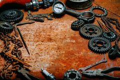 Motorcycle tools, equipment and repair, chain, tools on vintage metal background. Motorcycle tools, equipment and repair, old chain, tools on vintage metal royalty free stock image