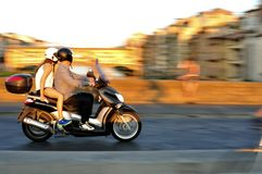 Motorcycle in traffic in Florence city in Italy Stock Photography