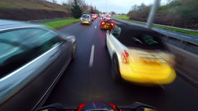 Motorcycle in traffic stock video footage