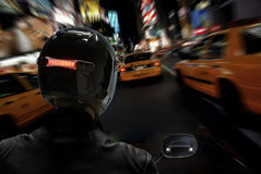 Motorcycle in Traffic Jam-Zoom Blur. A motorcyclist in heavy traffic in New York Royalty Free Stock Photography