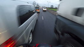 Motorcycle in traffic and landing plane stock footage