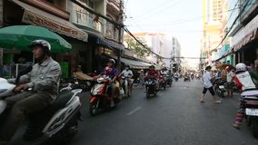 Motorcycle traffic in Saigon. stock footage