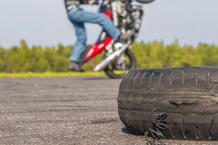 Motorcycle Tricks on unused runway Royalty Free Stock Images