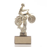 Motorcycle trophy. Motorcycle gold trophy isolated on white stock photography