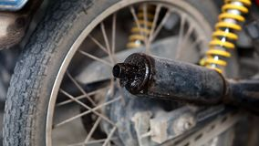 Motorcycle tube smoke. Closeup of motorbike exhaust pipe releasing fumes in the air stock footage