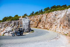 Motorcycle with two motorcyclists on a mountain road Stock Photography