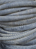 Motorcycle tyre. Background made of stack of used motorcycle tires Stock Images