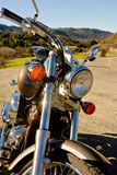 Motorcycle (Warm). Retro sepia tone of front forks of motorcycle Royalty Free Stock Images