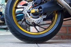 Motorcycle wheel and ABS brakes on street Royalty Free Stock Photo