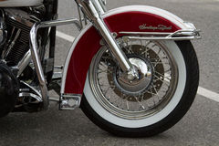 Motorcycle Wheel in Burgundy. A motorcycle is parked on the avenue Royalty Free Stock Photo