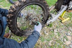 Motorcycle wheel close up. Mechanic fixing motocycle worn motorcycle drum breaks shoes stock photo