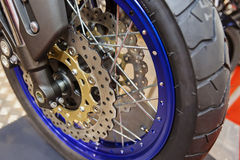 Motorcycle wheel closeup. Closeup of quality steel motorcycle wheel with new tyre; note shallow depth of field Royalty Free Stock Photo