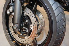 Motorcycle wheel closeup. Closeup of quality steel motorcycle wheel with new tyre; note shallow depth of field Stock Image