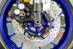 Motorcycle wheel details with brake and wheel spoke Royalty Free Stock Photos