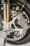 Motorcycle wheel with dic brakes and shocks close up stock images