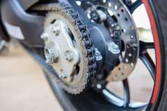 Motorcycle wheel and drive-chain and brake Stock Photo
