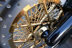 Motorcycle wheel with gold spokes Stock Photography