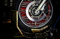 Motorcycle wheel in holder Stock Image