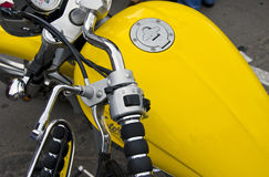 Motorcycle wheel and yellow petrol tank details. Stock Photo