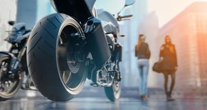 Motorcycle Wheels There is a woman back in the city. 3d redering and illustration Royalty Free Stock Image