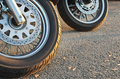 Motorcycle Wheels. Two motorcycle wheels parked in a road Royalty Free Stock Photo