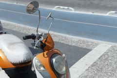 Motorcycle in white and orange in the afternoon in the parking lot. Side view.  Royalty Free Stock Images