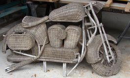 Motorcycle. Wicker motorcycle forgotten in the garage lying silent in hopes of being seen and revived Stock Images