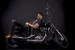 Motorcycle and young man Stock Photography