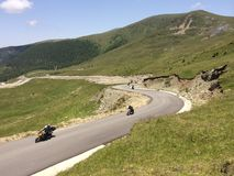 Motorcycles. Bikers riding on Transalpina mountain road in Romania Stock Photo