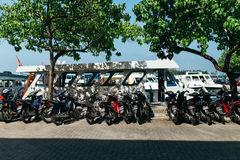 Motorcycles and boats in the city of Male, the capital of the Maldives Royalty Free Stock Photos