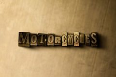 MOTORCYCLES - close-up of grungy vintage typeset word on metal backdrop Royalty Free Stock Photos