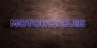 MOTORCYCLES - fluorescent Neon tube Sign on brickwork - Front view - 3D rendered royalty free stock picture Stock Photography