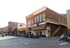 Motorcycles line the streets in historic downtown Deadwood South Dakota stock images