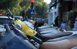 Motorcycles of many brands parking on a street side of Hanoi capital Royalty Free Stock Images