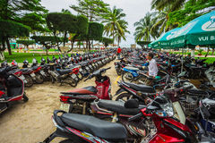 Motorcycles of many brands parking on a street side of NHA TRAN Stock Photo