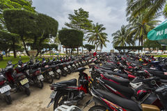 Motorcycles of many brands parking on a street side of NHA TRAN Royalty Free Stock Photo